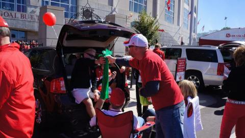 Tailgaters at Husker Game use green bags to recycle
